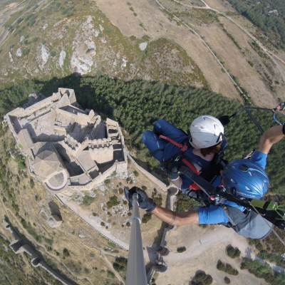 Two – seater paragliding over the castle